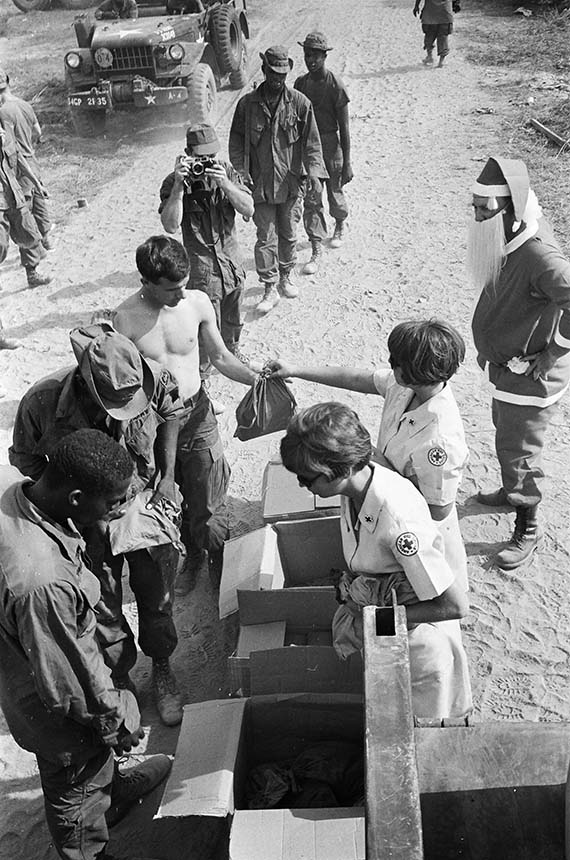 Our American Red Cross Volunteers Judi Wright & Char McClintic tirelessly hand out the Ditty Bags filled with Christmas gifts to soldiers of the 4th Bn/12th Inf. of the 199th Light Infantry Brigade.